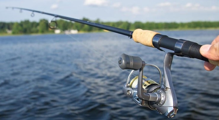 Holding Bass FIshing Rod