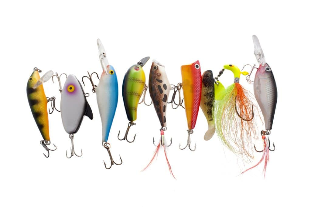 Close up image of different and colorful fishing lures against white background