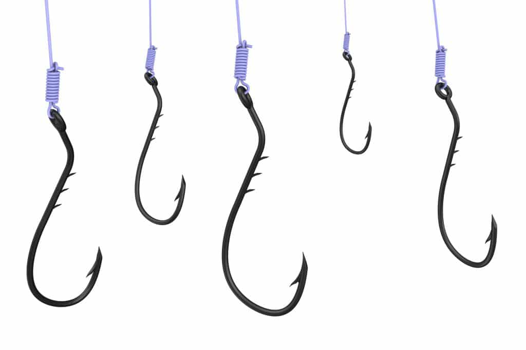 Fishing hooks on the fishing line. The three-dimensional illustration. Isolated