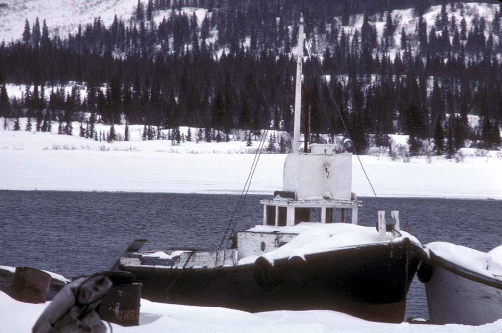 Boat floating in lake in winter time
