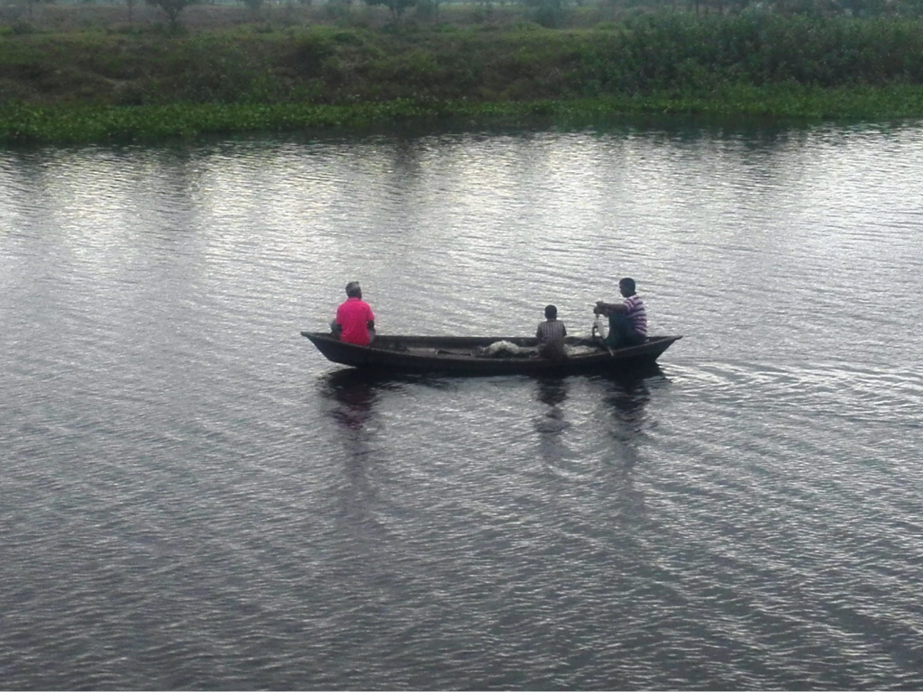 best fish finder for small boat with three men in a boat