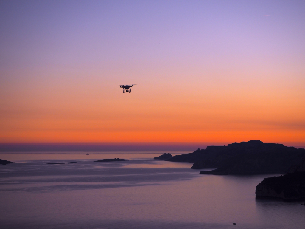 Drone flying on sunset