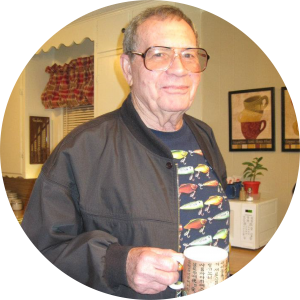 Bass Fishing expert Virgil Renfroe smiling and holding a coffee cup