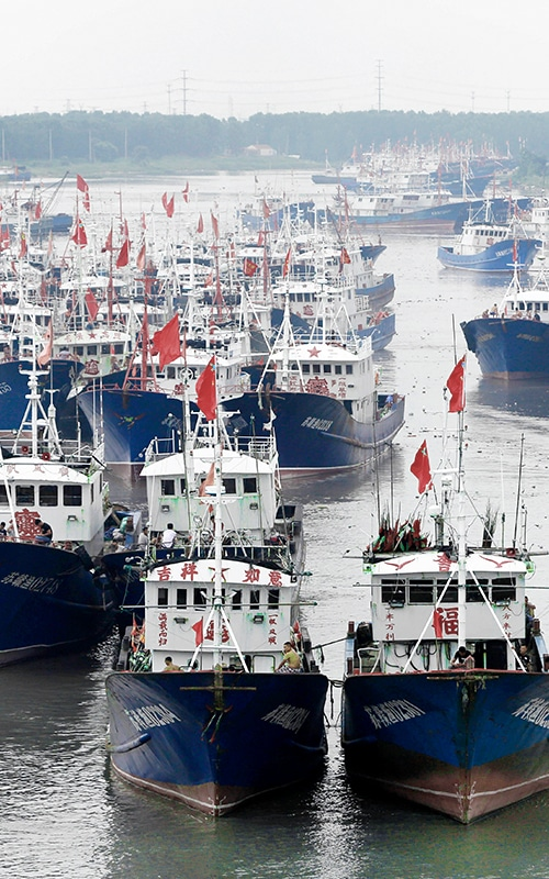 """Overfishing - """"Fishing boats on the water with asian writing on the sides"""""""