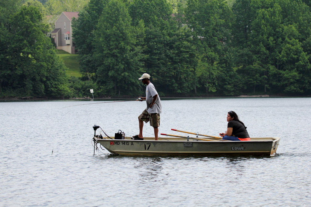 Man with woman fishing in the boat
