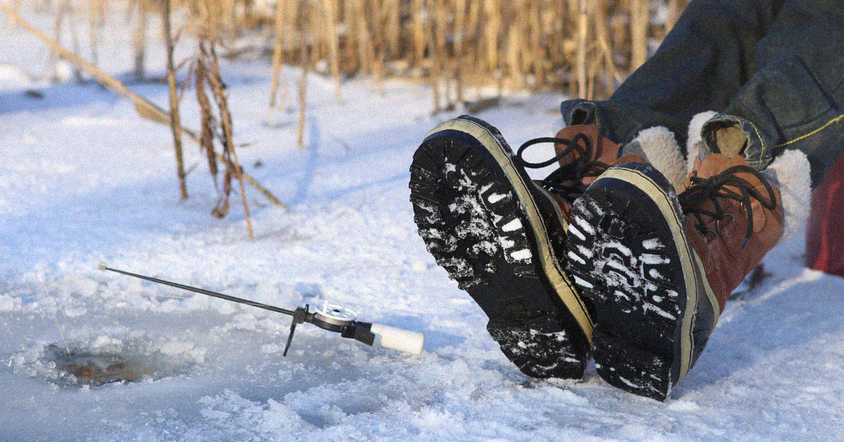 Person wearing boots while ice fishing